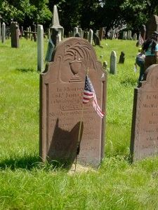 Grave stone with American flag.